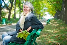 Free Pretty Young Woman Resting On A Bench Royalty Free Stock Image - 16796886