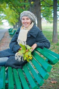 Pretty Young Woman Resting On A Bench Stock Photos