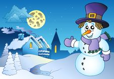 Free Snowman Near Small Village Stock Image - 16796991