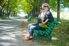 Pretty Young Woman Resting On A Bench Stock Images
