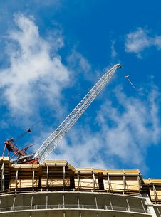 Free Crane On Top Of New Condo Tower Royalty Free Stock Images - 16797379