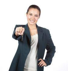 Free Young Hispanic Female Handing A Set Of House Keys Stock Photos - 16798273