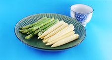 Fresh Asparagus Shoots And Corn On A Plate Royalty Free Stock Photo