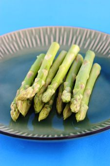 Fresh Asparagus Shoots On A Plate Royalty Free Stock Image