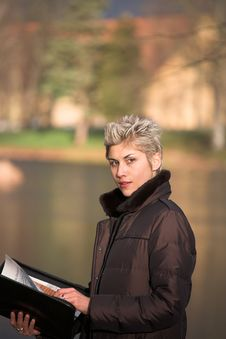 Free Business Woman Outdoor Reading Royalty Free Stock Image - 1680956