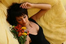 Free Young Girl With Flowers Laying On A Sofa Stock Photos - 1686003