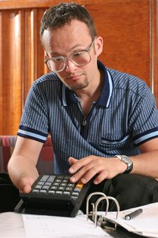 Man With Calculator Stock Image