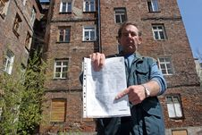 Free Man In Front Of Ruined House Stock Photography - 1689152