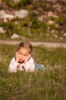 Free Beautiful Girl  Lying On The Grass Stock Photography - 16800362