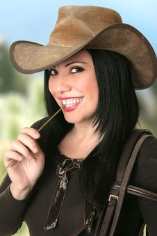 Free Smiling Cowgirl Chewing On Lucerne Stock Photos - 16805923