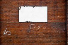 Blank Billboard On A Stone Wall. Royalty Free Stock Photography