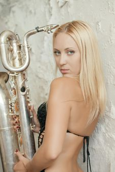 The Girl And A Saxophone Stock Photos