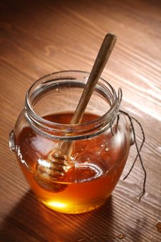 Free Pot Of Honey And Wooden Stick In It. Royalty Free Stock Image - 16809296