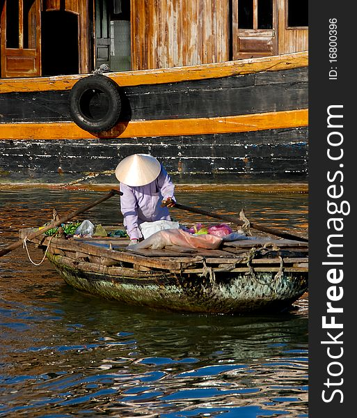 Woman on boat, floating market