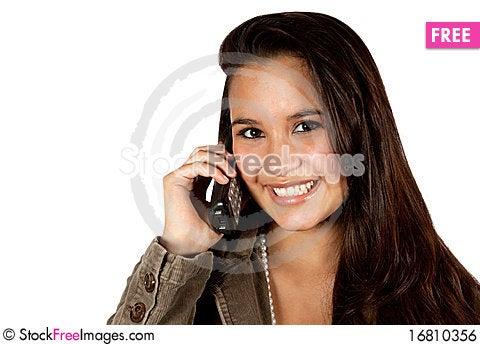 Free Young Hispanic Female On Telephone Royalty Free Stock Image - 16810356