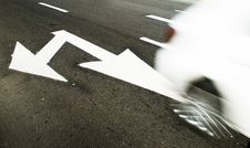 White Arrow Sign On Road Royalty Free Stock Photography