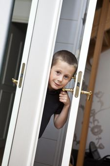 Free Little Boy By The Door Royalty Free Stock Photos - 16811608