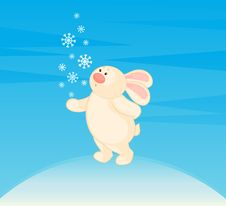 Little Toy Bunny With Snowflakes Stock Image