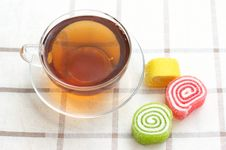 Free Colored Jelly And Mug With Tea Stock Photos - 16814653