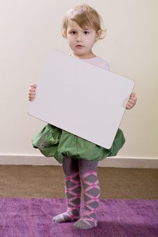 Free Girl Holding A White Board Royalty Free Stock Photography - 16815247