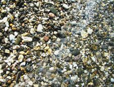Background.Pebble On A Beach In Sea Water Stock Images