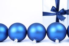 Christmas Balls And A Gift Background Royalty Free Stock Images