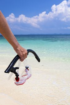 Woman Carrying Snorkeling Equipment. Stock Photo