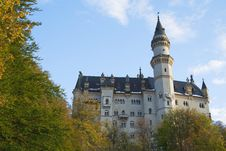 Neuschwanstein Castle In Trees Stock Photo