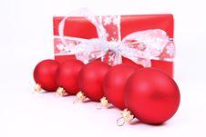 Christmas Balls And A Gift Stock Image
