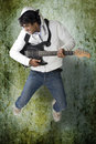 Free Dancing Guitar Player Royalty Free Stock Photos - 16827938