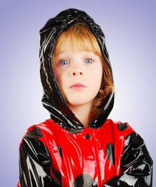 Free Child With Funny Face  In Rain Coat. Stock Photos - 16821353