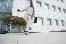 Free Businessman On Skateboard Royalty Free Stock Image - 16822796