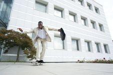 Free Businessman On Skateboard Stock Image - 16822841