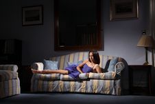 Concept Lighting Beautiful Fashion Model On Sofa Stock Photo