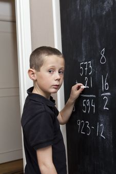 Free Boy At The Blackboard Royalty Free Stock Photos - 16823588