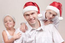 Free Happy Children And Man In Santa Hat Stock Photography - 16823812