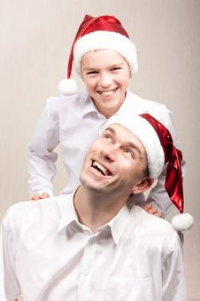 Free Happy Teen And Man In Santa Hat Royalty Free Stock Photo - 16823825