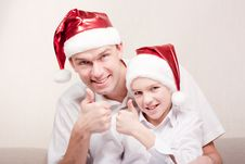 Happy Teen And Man In Santa Hat Stock Images