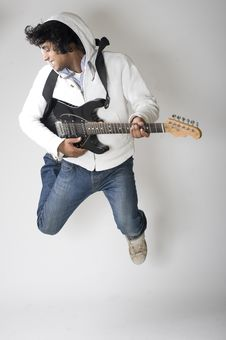 Dancing Guitar Player Royalty Free Stock Photography