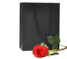 Black Gift Bag With Red Rose Stock Photography
