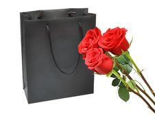 Free Black Gift Bag With Red Roses Stock Photography - 16827532