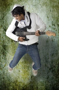 Dancing Guitar Player Royalty Free Stock Photos