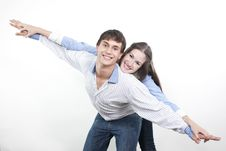 Free Couple With The Hands Lifted Upwards Royalty Free Stock Image - 16828796