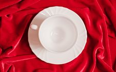 White Cup On The Red Velvet Royalty Free Stock Photography