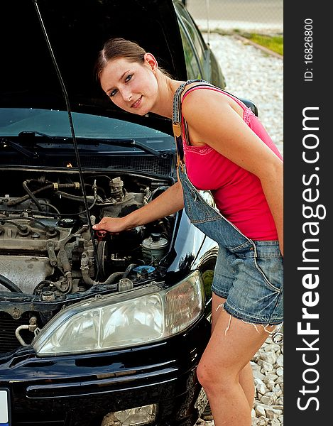 Woman with her broken down car