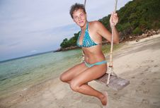 Free Woman Riding On A Swing On The Beach Stock Image - 16830431