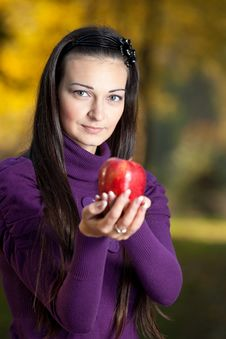 Offering An Apple Royalty Free Stock Photography