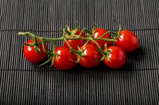 Free Cherry Tomatoes On Bamboo Rag Stock Photography - 16836952
