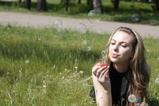 Free Girl Blowing Soap Bubbles Royalty Free Stock Photography - 16837097
