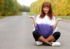Free Woman Is Sitting On The Road Stock Image - 16837191